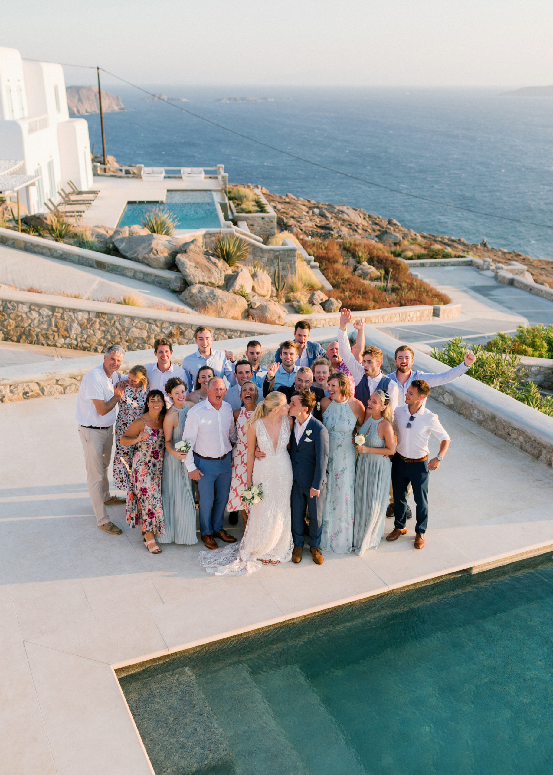 Micro wedidng in Greece - Couple in Mykonos kissing after their intimate wedding celebration in their villa.